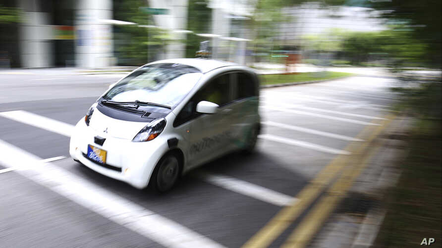 An autonomous vehicle is driven during its test drive in Singapore Wednesday, Aug. 24, 2016.