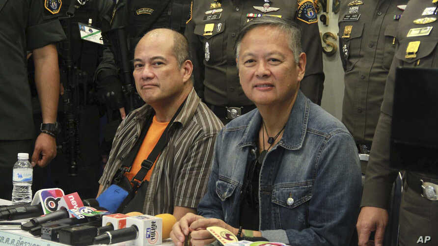 Ex-municipal mayor, Mario Reyes, left, and former Gov. Joel Reyes of western Palawan island province attend a press conference at Crime Suppression Division in Bangkok, Thailand, Monday, Sept. 21, 2015.