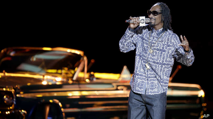 FILE - Rapper Snoop Dogg takes the stage to host the BET Hip Hop Awards, Sept. 28, 2013, in Atlanta.