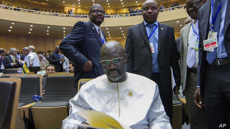 Liberia's recently-elected President George Weah attends the opening ceremony of the African Union summit in Addis Ababa, Ethiopia Sunday, Jan. 28, 2018.