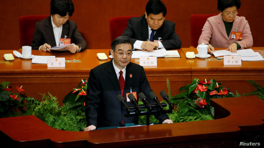 Zhou Qiang, President of China's Supreme People's Court, gives a speech during the third plenary session of the National People's Congress (NPC) at the Great Hall of the People, in Beijing, March 12, 2017.