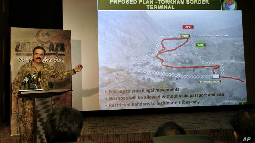 Pakistani army spokesman Lt Gen. Asim Bajwa briefs the media regarding the Torkham Border Terminal construction on the Pakistan-Afghan border crossing during a press conference addressing the ongoing military offensive in tribal areas and clashes at