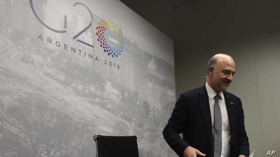 European Financial Affairs Commissioner Pierre Moscovici arrives to give a press conference during the G-20 meeting of finance ministers and central bank governors in Buenos Aires, Argentina, July 22, 2018.