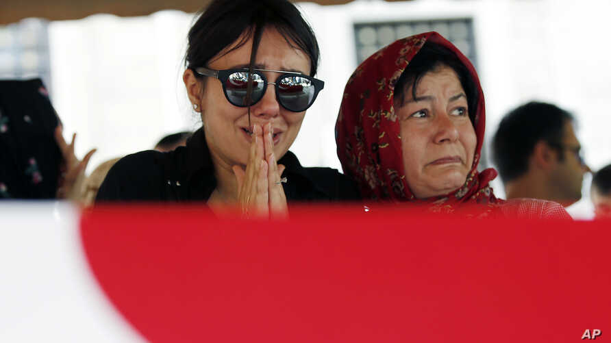 Family members and friends attend the funeral prayer for Gulsen Bahadir, 28, a Turkish Airlines (THY) flight attendant killed Tuesday at the blasts at Ataturk airport, in Istanbul, June 29, 2016.