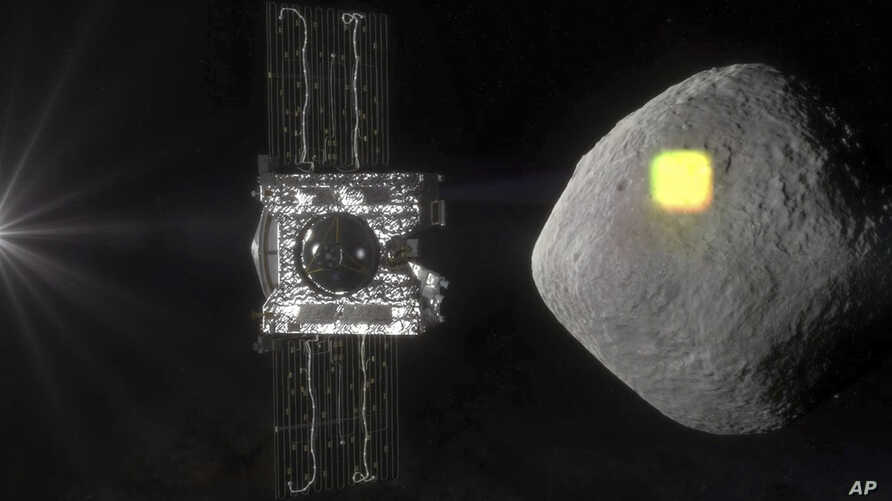 FILE - This artist's rendering made available by NASA in July 2016 shows the mapping of the near-Earth asteroid Bennu by the OSIRIS-REx spacecraft.