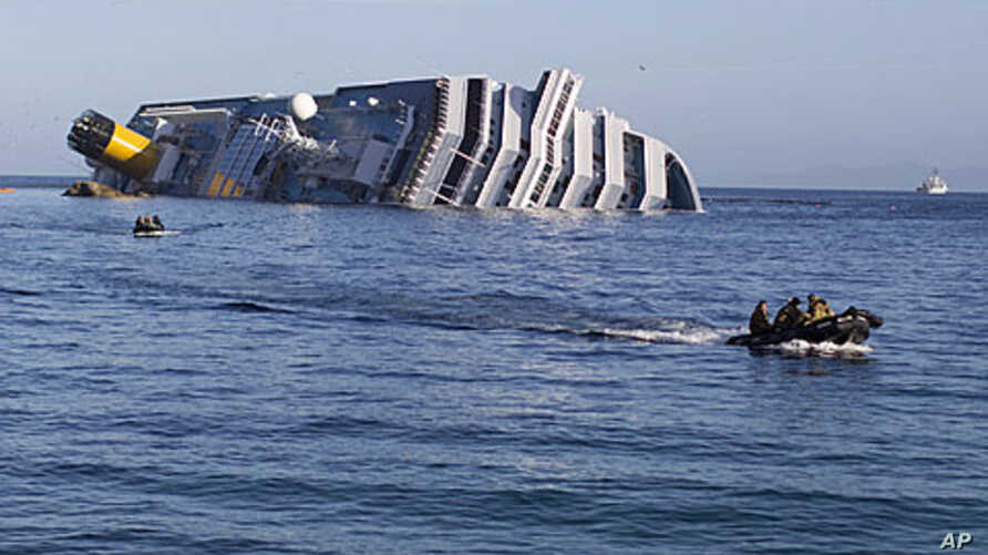 Navy teams conducting rescue efforts are seen January 21, 2012, near the Costa Concordia cruise ship which ran aground off the west coast of Italy at Giglio island.