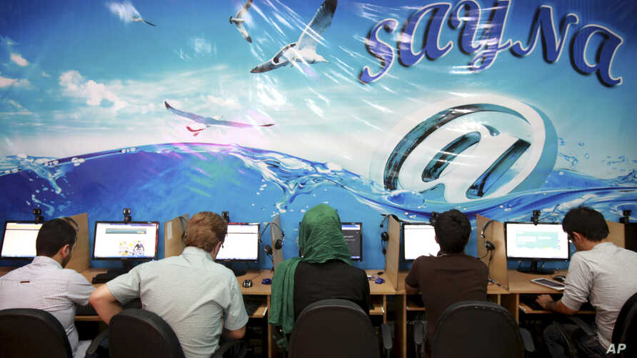 FILE - Iranians surf the internet at a cafe in Tehran, Iran, Sept, 17, 2013. In Iran, a government push for a 'halal' internet means more control after protests.