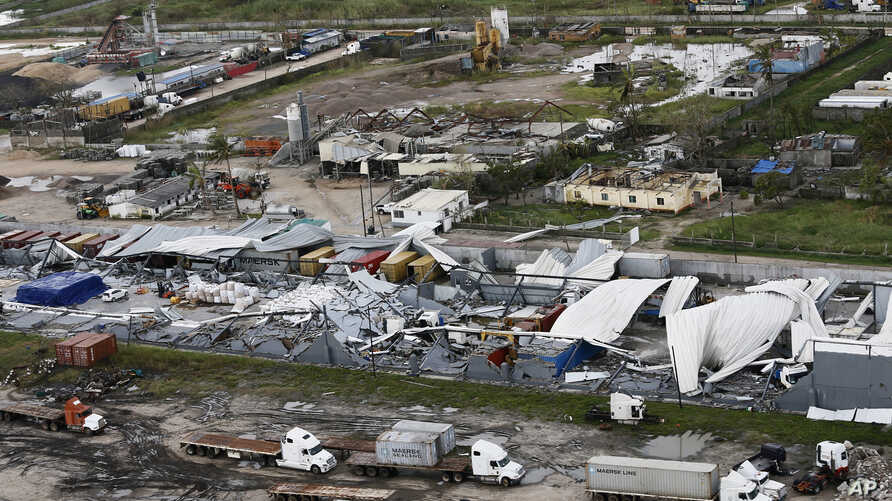 An aerial photo shows a damaged factory following the devastating Cyclone Idai in Beira, Mozambique, March 23, 2019.