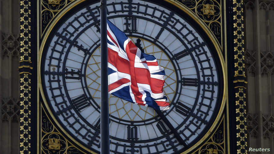 FILE - A Union flag flies in front of the Big Ben clock face abover the Houses of Parliament in central London, Britain, April 18, 2017.