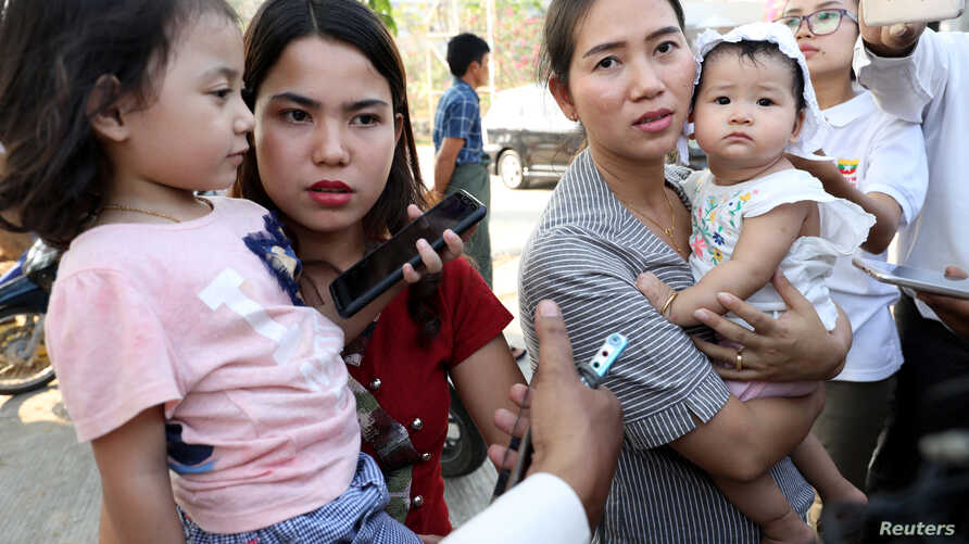 Families of jailed Reuters reporters Wa Lone and Kyaw Soe Oo talk to the media after attending a hearing at Myanmar's Supreme Court in Naypyitaw, Myanmar, March 26, 2019.