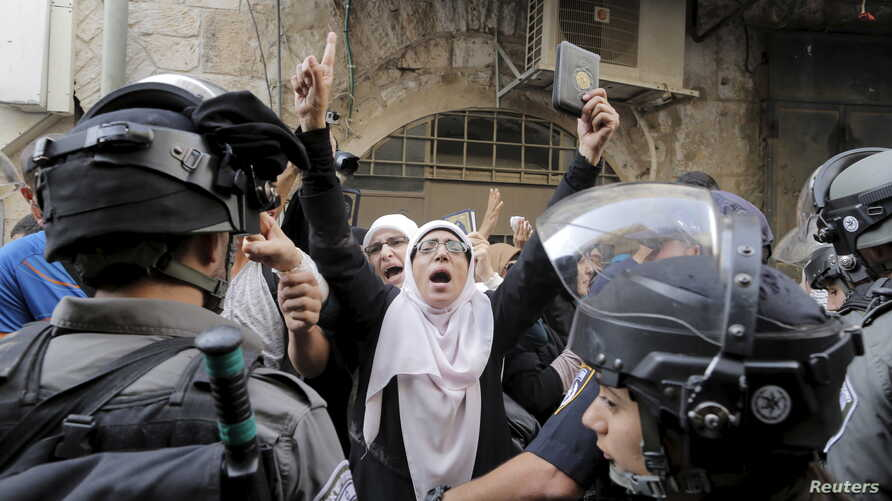 Israeli policemen prevent Palestinian women from entering the compound which houses al-Aqsa mosque, known by Muslims as the Noble Sanctuary and by Jews as the Temple Mount, in Jerusalem's Old City, Sept. 13, 2015.