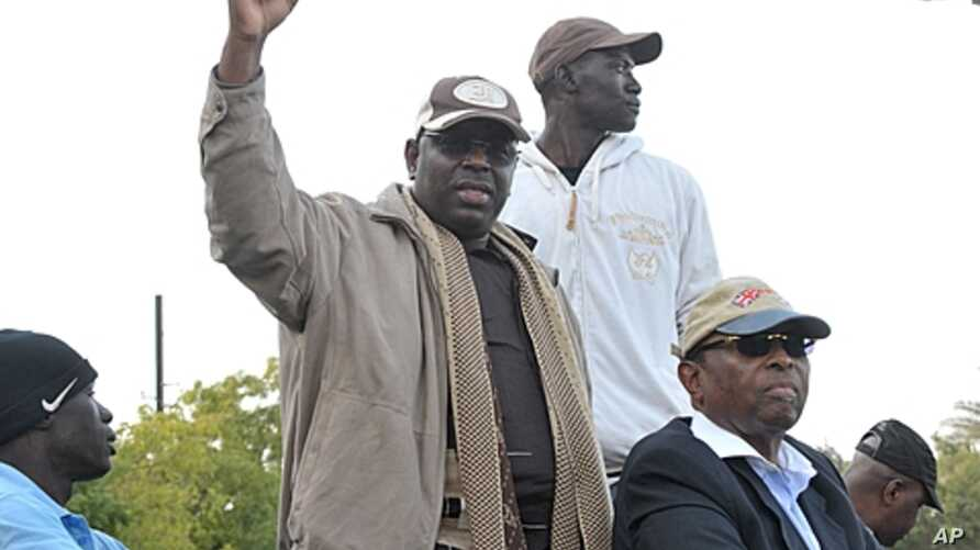Senegalese opposition leader Macky Sall gestures as he attends a demonstration demanding that President Abdoulaye Wade drop plans to seek a third term in Dakar, Senegal, January 31, 2012.