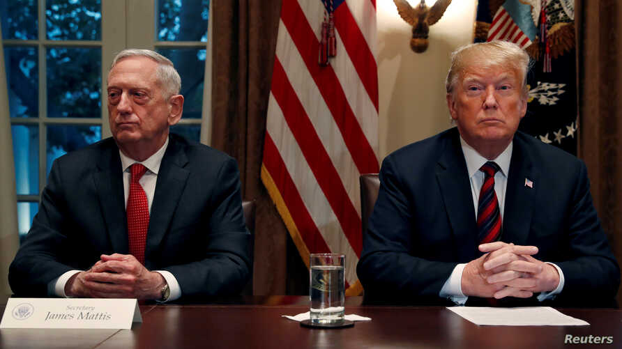 FILE - President Trump gets a briefing from his senior military leaders, including Defense Secretary James Mattis (L), in the Cabinet Room at the White House, October 23, 2018.