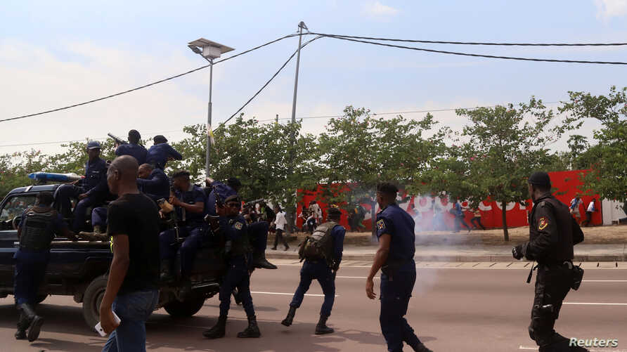 FILE - Riot policemen fire tear-gas canisters to disperse supporters of Congolese opposition presidential candidate Martin Fayulu as they welcome him at N'djili International Airport in Kinshasa, Democratic Republic of Congo Nov. 21, 2018.