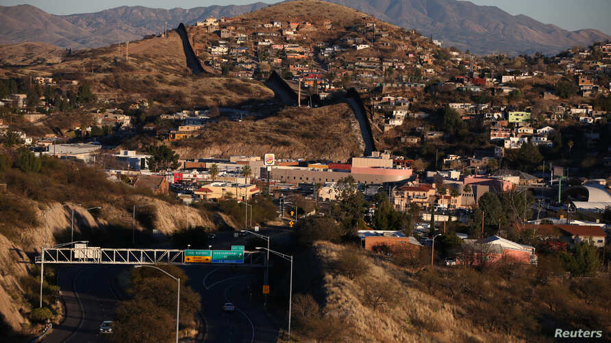 FILE - The U.S. border with Mexico is seen in Nogales, Arizona, U.S., January 31, 2017.
