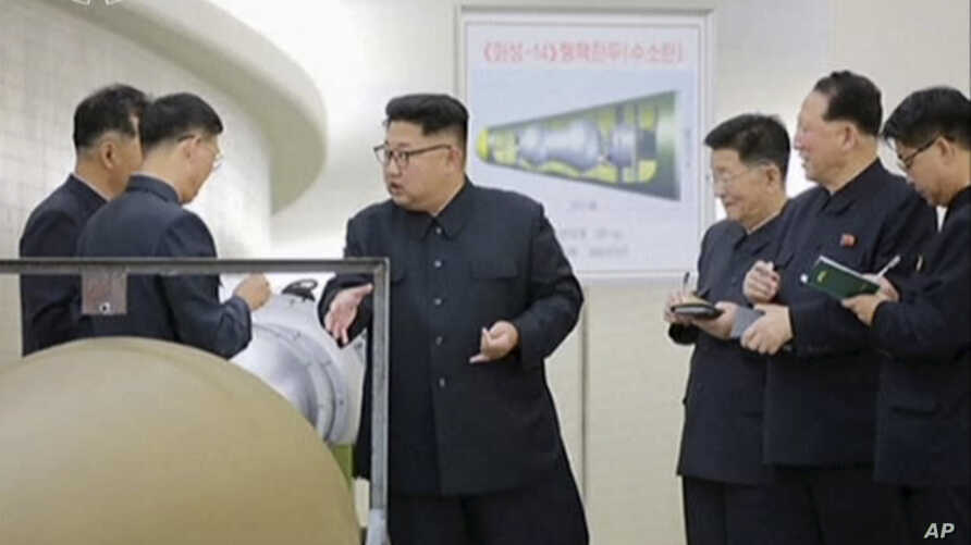 Image made from video by North Korea's KRT released on Sunday, Sept. 3, 2017, shows North Korean leader Kim Jong Un at an undisclosed location.