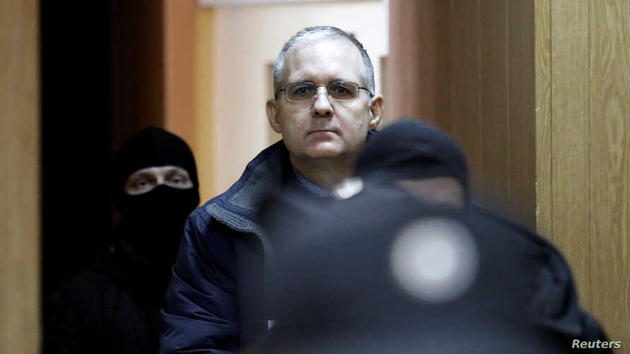 FILE - Former U.S. marine Paul Whelan, who is being held on suspicion of spying, is escorted out of a courtroom, in Moscow, Russia, Feb. 22, 2019.