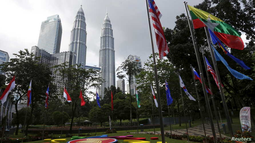 FILE - National flags and the Association of Southeast Asian Nations logo are on display ahead of an ASEAN summit in Kuala Lumpur, Malaysia, Nov. 18, 2015.