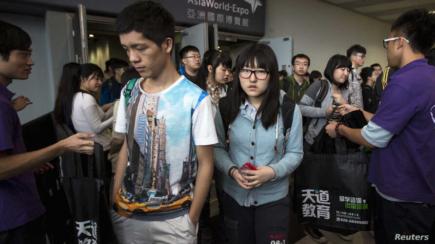 FILE - Students leave after a Scholastic Assessment Test session at AsiaWorld-Expo in Hong Kong Nov. 2, 2013.