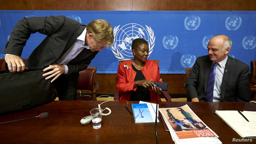 U.N. humanitarian chief Valerie Amos, center, speaks with World Health Organization Assistant Director General Bruce Aylward, left, and Dr. David Nabarro, senior U.N. coordinator for Ebola, after a news conference on Ebola at the United Nations in Ge
