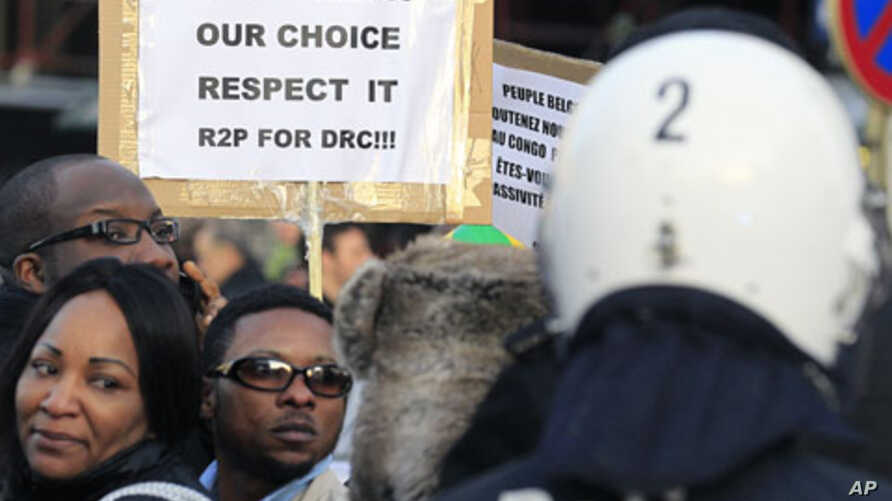 Supporters of Congolese opposition leader Etienne Tshisekedi, who has rejected results declaring President Joseph Kabila the winner, demonstrate in Brussels, December 10, 2011.