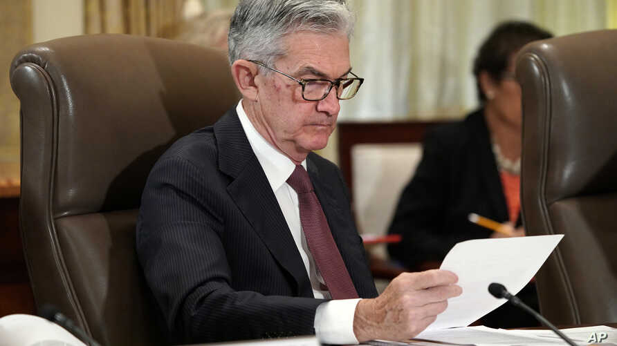 Federal Reserve Chair Jerome Powell looks over papers as the Federal Reserve Board holds a meeting at the Marriner S. Eccles Federal Reserve Board Building in Washington, Oct. 31, 2018.