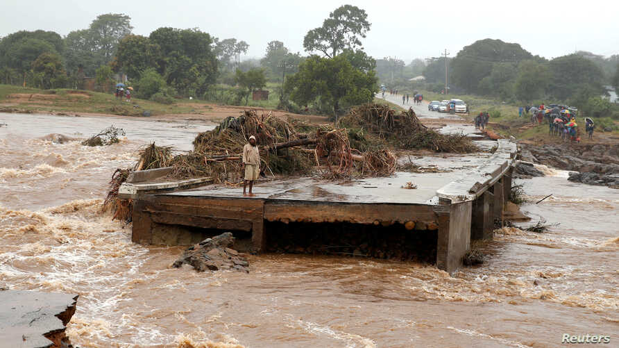 A man looks at a washed away bridge along Umvumvu river following Cyclone Idai in Chimanimani, Zimbabwe, March 18, 2019.