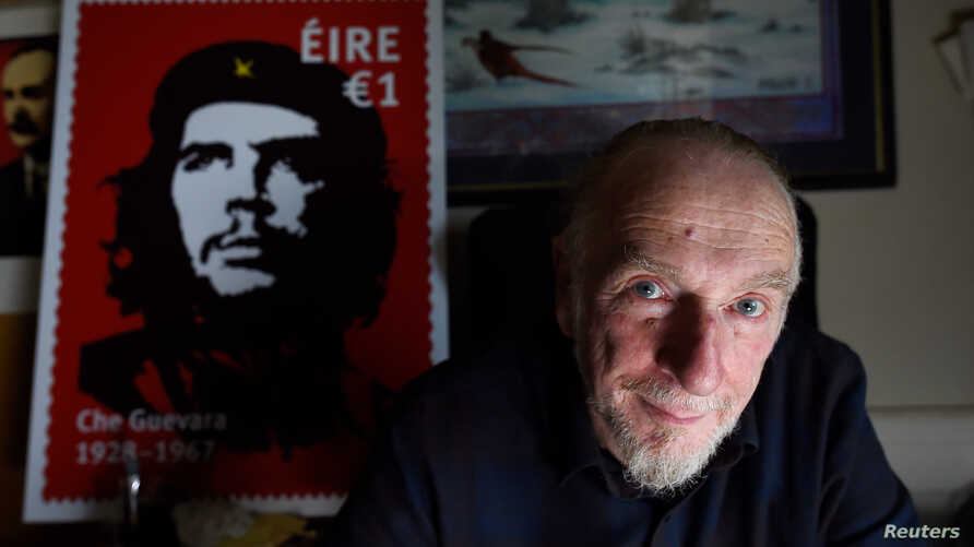 Artist Jim Fitzpatrick who has created an Irish postage stamp using the poster of Che Guevara he created in 1968 entitled 'Viva Che!' based on a photograph by Alberto Korda poses for a picture at his studio in Dublin, Ireland, Oct. 11, 2017.