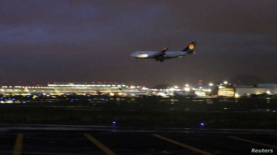A Lufthansa Boeing 747 aircraft approaches for landing at Benito Juarez International Airport in Mexico City, July 28, 2012.
