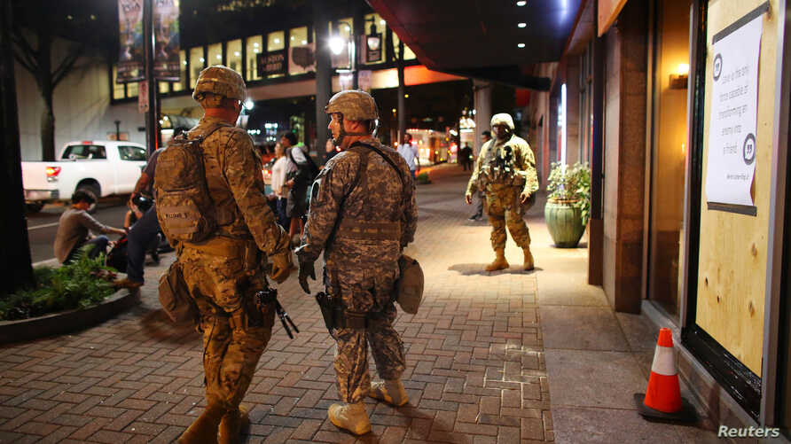 U.S. National Guard soldiers prepare for another night of protests over the police shooting of Keith Scott in Charlotte, North Carolina, Sept. 22, 2016.
