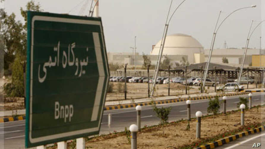 """A sign reading """"Atomic Power plant"""" points the way to the nuclear power plant in Bushehr, Iran,  Feb. 25, 2009."""