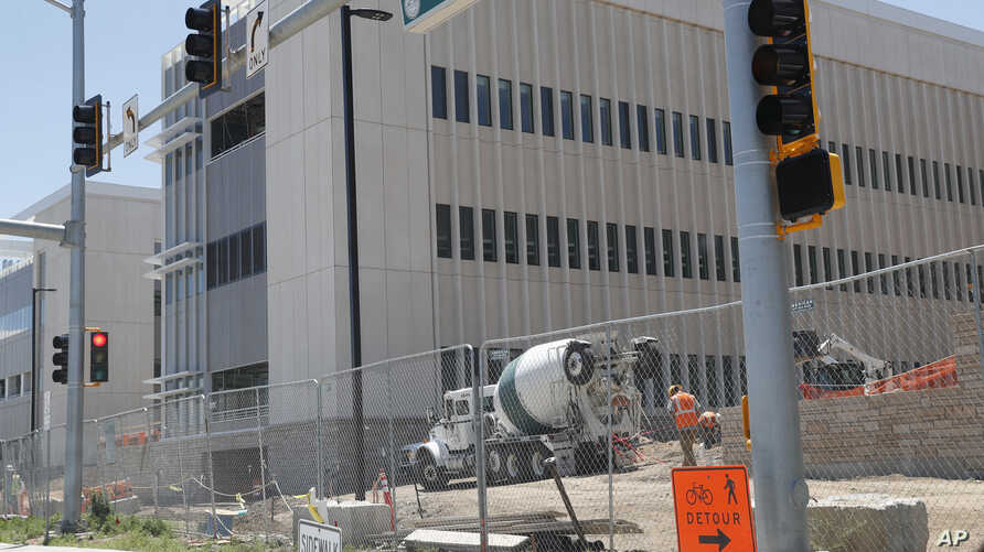 One of the buildings on the campus of the Veterans Administration hospital still under construction, June 8, 2017, in Aurora, Colo. The United States Justice Department has declined to prosecute Veterans Affairs Department executives after lawmakers
