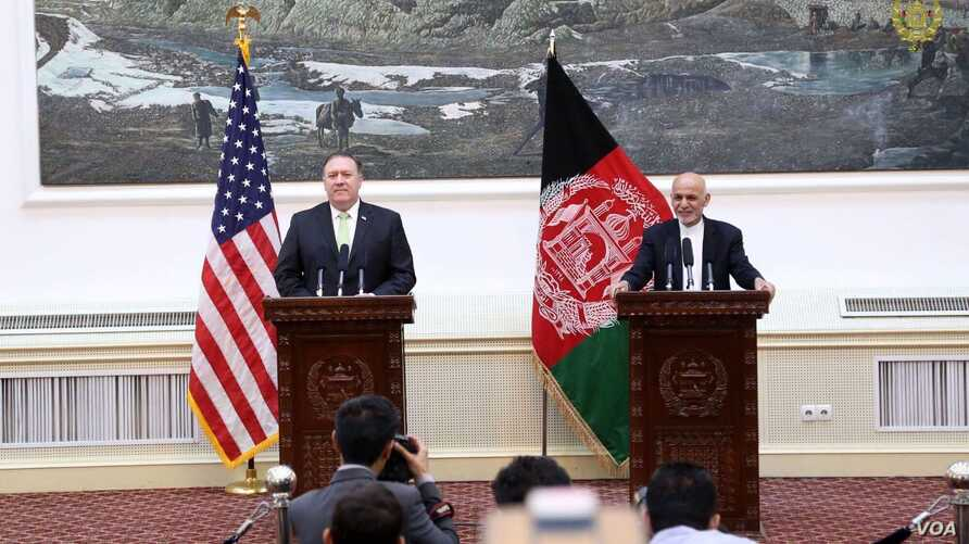 Afghan President Ashraf Ghani (right), and U.S. Secretary of State Mike Pompeo speak at a joint press conference at the Presidential Palace, in Kabul, Afghanistan, July 9, 2018. (Courtesy - Presidential Palace)