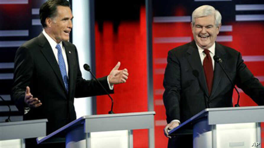 U.S. Republican presidential candidates Mitt Romney, left, and Newt Gingrich, Des Moines, Iowa, Dec. 10, 2011.