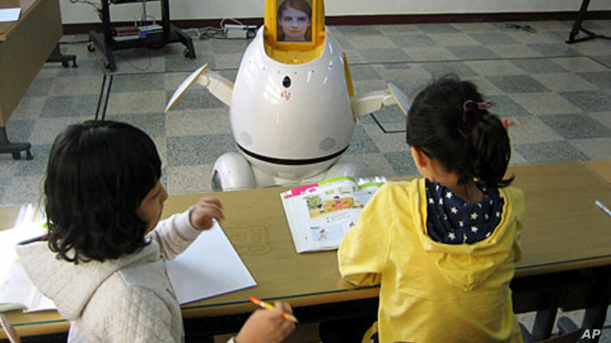 Students learn from Engkey, the robot at the Hagjeong Primary School in Daegu