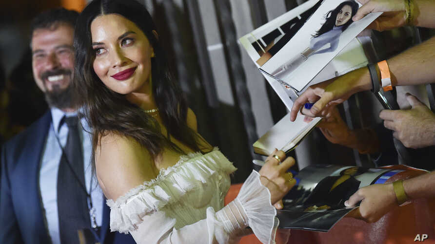 """FILE - In this Sept. 6, 2018, file photo, actress Olivia Munn attends the premiere for """"The Predator"""" on Day 1 of the Toronto International Film Festival, at the Ryerson Theater in Toronto."""