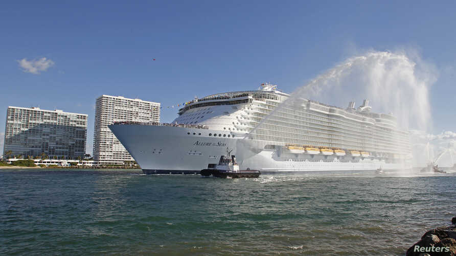 FILE - Royal Caribbean International's cruise ship 'Allure of the Seas' enters its new home port in Fort Lauderdale as seen from nearby Hollywood, Florida, Nov. 11, 2010.