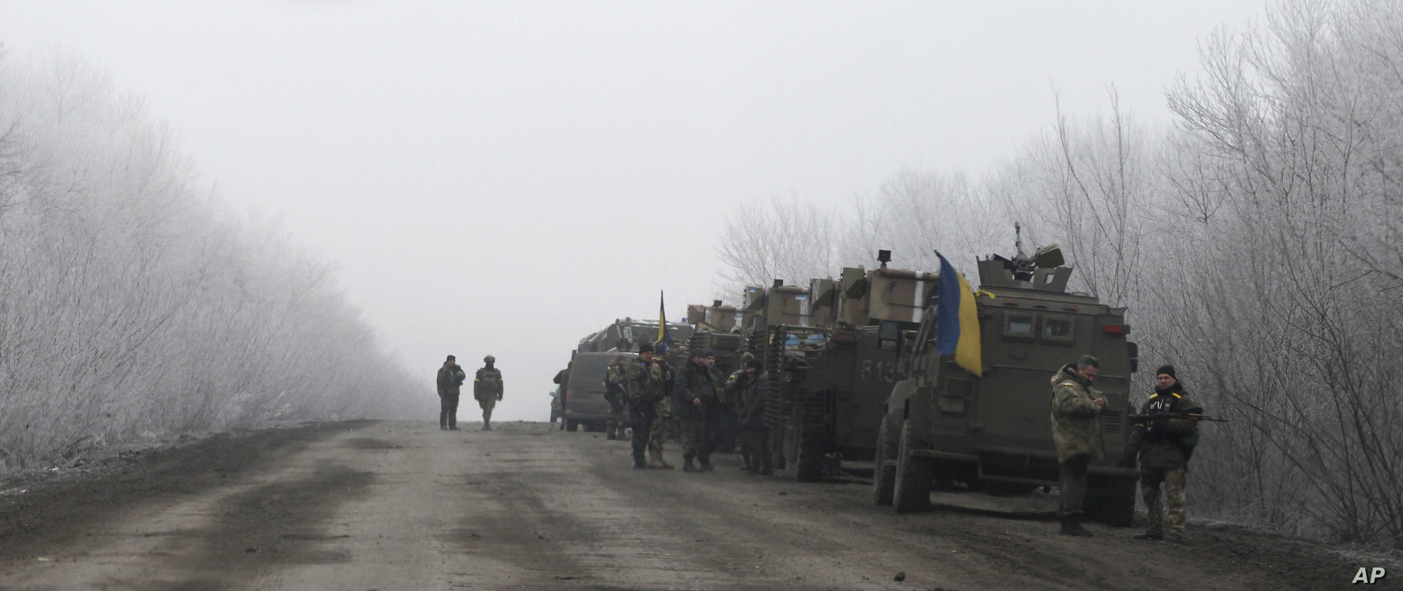 Ukrainian military convoy stop on the road between the towns of Dabeltseve and Artemivsk, Ukraine, Feb. 14, 2015.