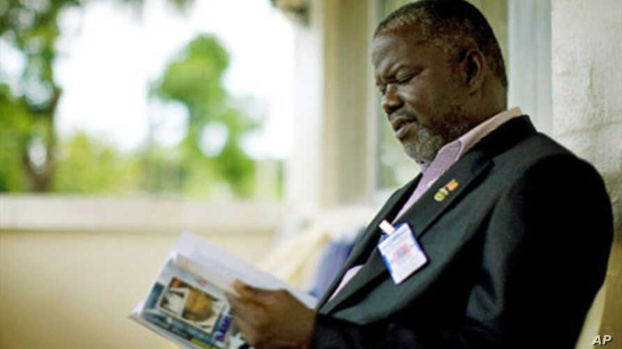 Former Liberian warlord and current senator Prince Johnson reads in his home in Monrovia (June 2009 file photo)