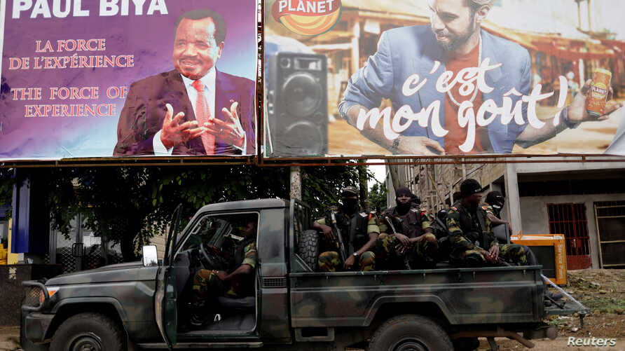 Cameroonian elite Rapid Intervention Battalion (BIR) members sit on their military vehicle during a patrol in the souhwest city of Buea, Cameroon, Oct. 4, 2018.