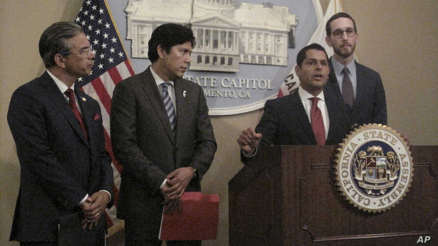 Assemblyman Miguel Santiago, D-LA, second from right, speaks at a news conference at the state Capitol as Assemblyman Rob Bonta, D-Oakland, from left, Sen. Kevin de Leon, D-LA, and Sen. Scott Wiener, D-San Francisco, listen in Sacramento, California,