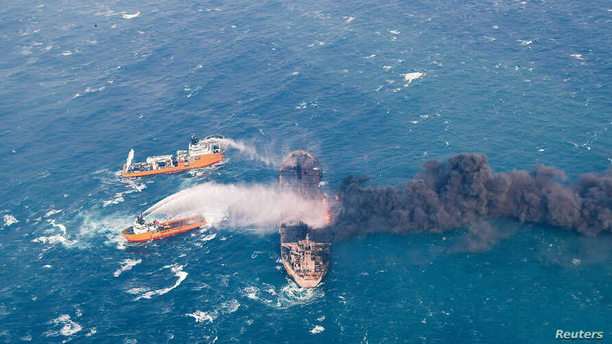 Rescue ships work to extinguish the fire on the Panama-registered Sanchi tanker carrying Iranian oil, which caught fire after a collision with a Chinese freight ship in the East China Sea, in this Jan. 10, 2018, photo provided by China's Ministry of