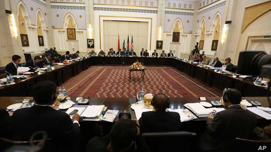 Delegations from Afghanistan, Pakistan, the United States and China discuss a road map for ending the war with the Taliban at the Presidential Palace in Kabul, Afghanistan, Feb. 23, 2016.