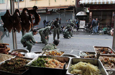 Thai security personnel collect evidence as they investigate at the site of a bomb attack in the southern Yala province, Feb. 21, 2011.