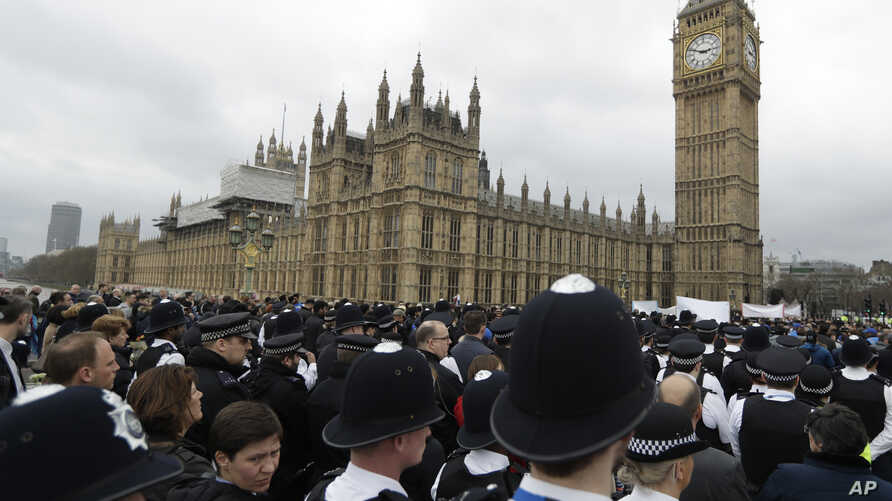 Police officers take part in a commemorative event to mark last week's attack outside Parliament that killed four people on Westminster Bridge in London, March 29, 2017.