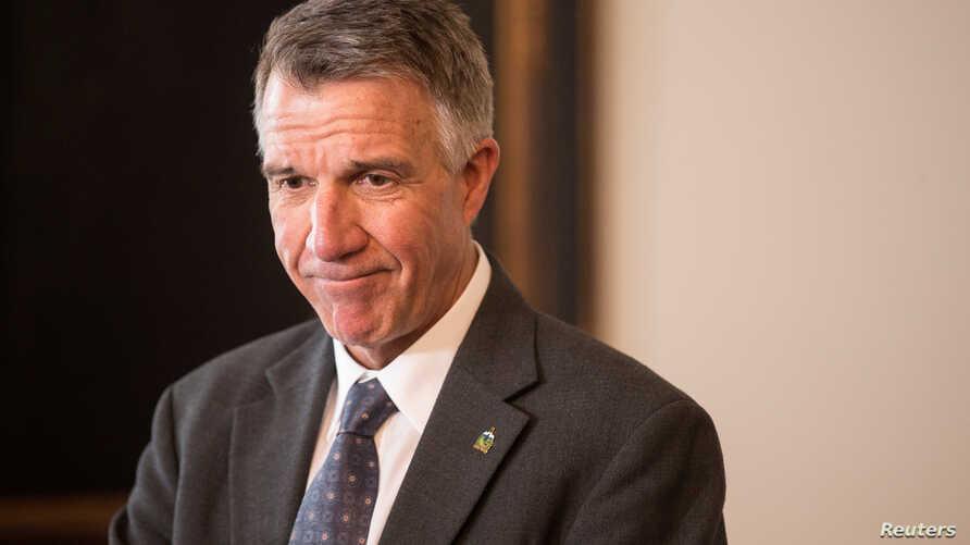FILE - Vermont Gov. Phil Scott speaks to reporters in his offices at the State Legislature in Montpelier, March 13, 2018.