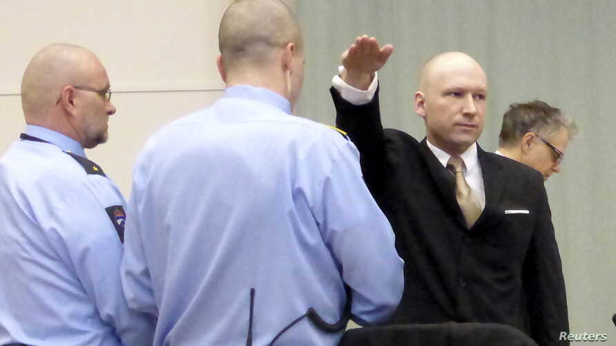 Mass killer Anders Behring Breivik raises his arm in a Nazi salute as he enters the court room in Skien prison, Norway, March 15, 2016.