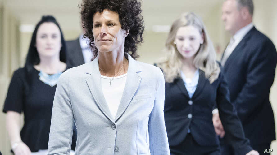 Andrea Constand walks to the courtroom during Bill Cosby's sexual assault trial at the Montgomery County Courthouse in Norristown, Pa., June 6, 2017.