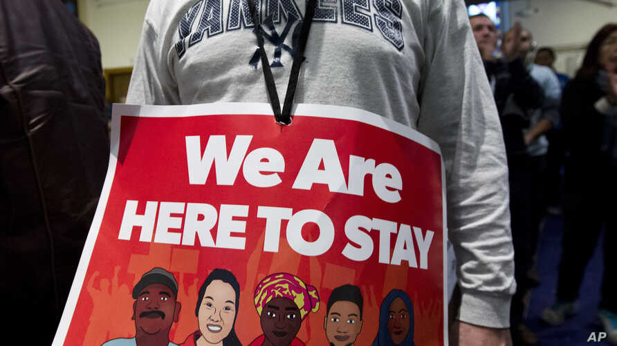 Immigrant rights advocates demonstrate against President-elect Donald Trump's immigration policies, during a rally at Metropolitan AME Church in Washington, Jan. 14, 2017.