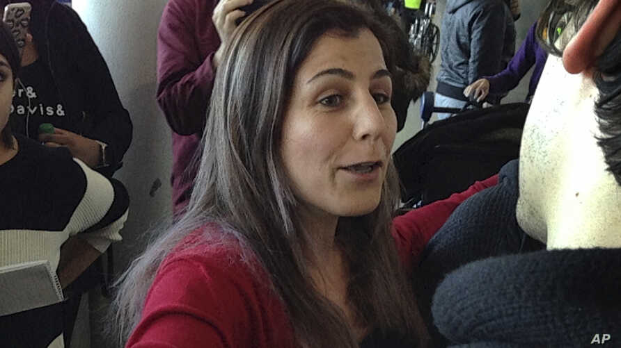 Vahideh Rasekhi, an Iranian doctoral student at Stony Brook University, greets friends and family as she is released from detention at John F. Kennedy International Airport in New York, Sunday, Jan. 29, 2017.